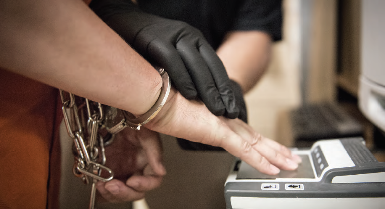 US_Marshals_fingerprinting_prisoner.png