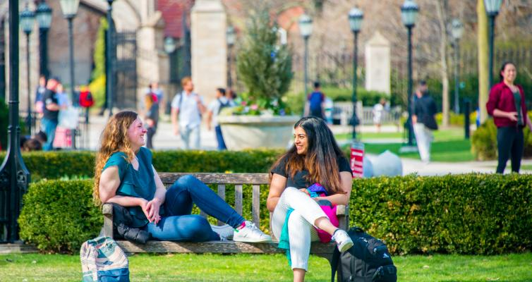 students on bench in quad